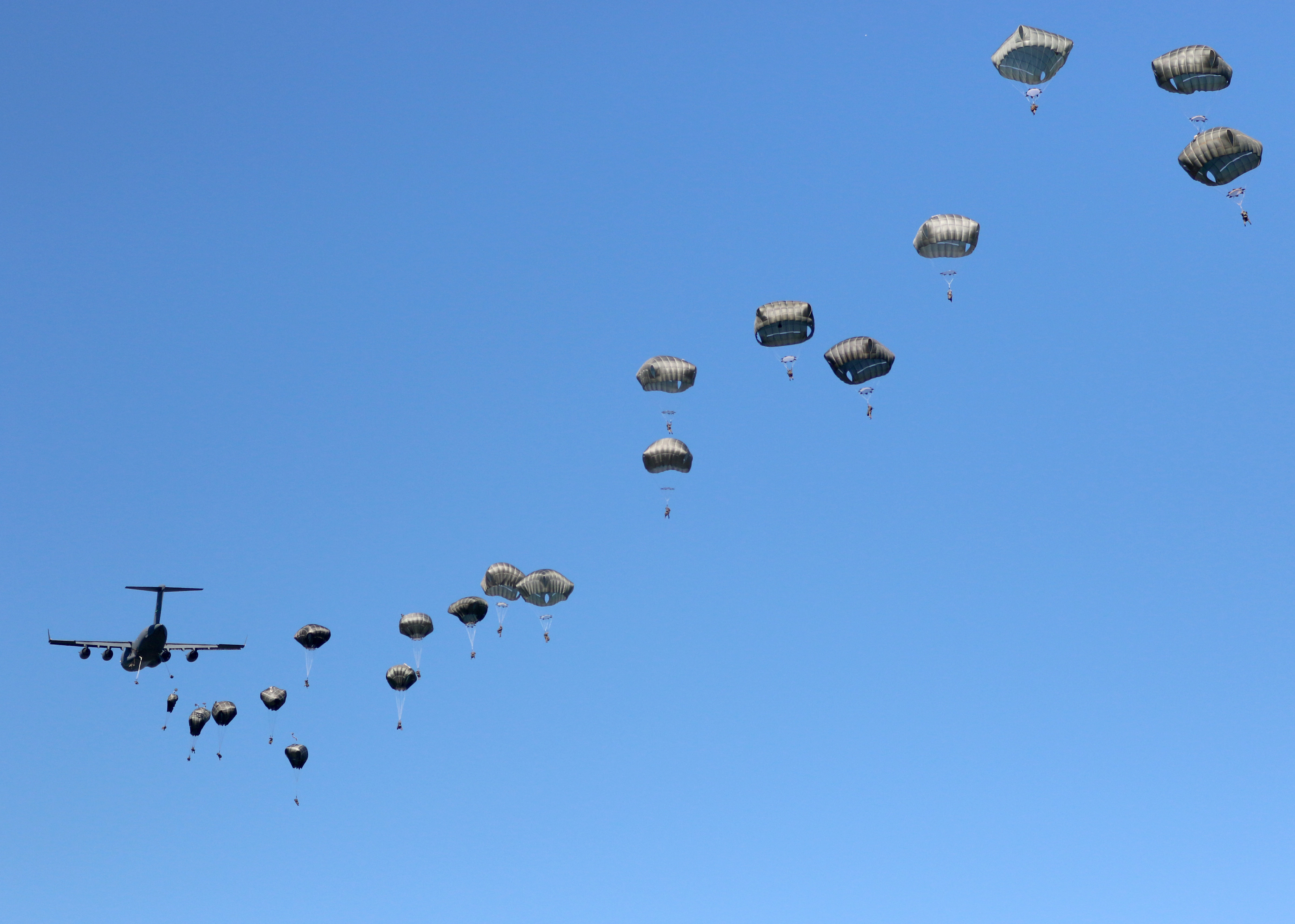 Paratroopers assigned to 1st Brigade Combat Team, 82nd Airborne Division fill the skies over a drop zone in Torun, Poland during Exercise Swift Response 16, June 7
