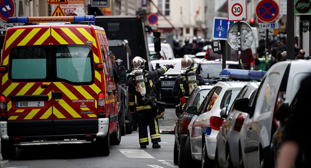 French firemen secure the street as a man has taken two people hostage at a business in Paris, France, June 12, 2018
