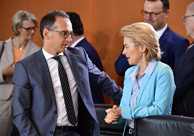 German Foreign Minister Heiko Maas chats with Defence Minister Ursula von der Leyen before the weekly cabinet meeting in Berlin on June 13, 2018