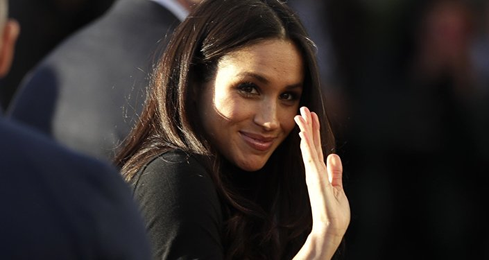 Meghan Markle waves as she leaves with Prince Harry after watching a hip hop opera performance by young people involved in the Full Effect programme at the Nottingham Academy school in Nottingham, England, Friday Dec. 1, 2017