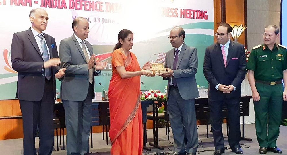 The Hon'ble Defence Minister, Smt Nirmala Sitharaman, inaugurating the first Representative Office of BEL in Vietnam by handing over the symbolic key to Mr Gowtama M V, CMD, BEL, during the Vietnam-India Defence Industry Business Meeting held at Hotel Melia, Hanoi
