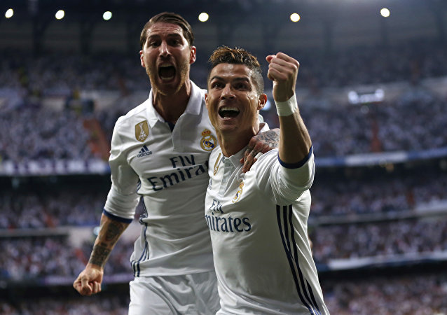 Real Madrid's Cristiano Ronaldo celebrates with Real Madrid's Sergio Ramos after scoring the opening goal during the Champions League semifinals first leg soccer match between Real Madrid and Atletico Madrid at Santiago Bernabeu stadium in Madrid, Spain, Tuesday May 2, 2017