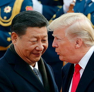 In this Nov. 9, 2017, file photo, U.S. President Donald Trump, right, chats with Chinese President Xi Jinping during a welcome ceremony at the Great Hall of the People in Beijing