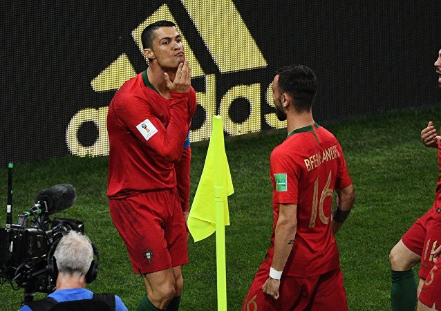 Soccer Football - World Cup - Group B - Portugal vs Spain - Fisht Stadium, Sochi, Russia - June 15, 2018 Portugal's Cristiano Ronaldo celebrates scoring their first goal
