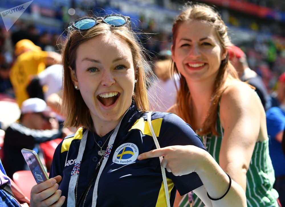 Female fans posing for a photo before a group stage World Cup match between France and Australia.