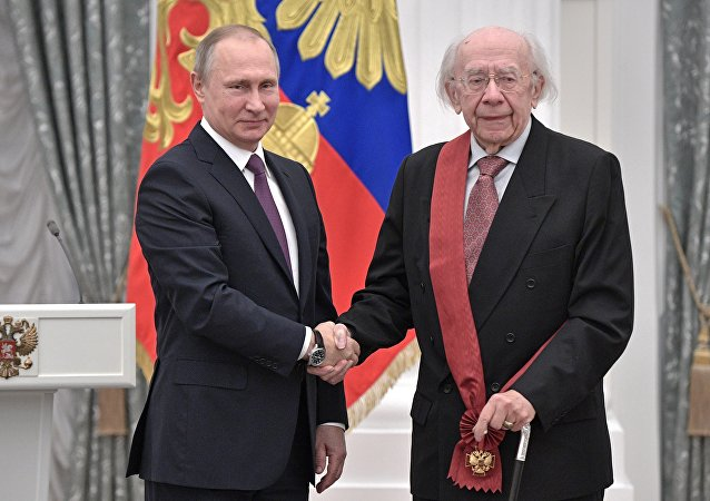 Russian President Vladimir Putin presents a medal to conductor Gennady Rozhdestvensky during a state award ceremony in the Kremlin in Moscow, Russia, Wednesday, May 24, 2017