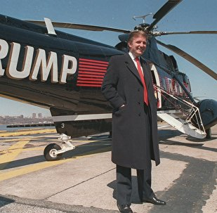 Donald Trump stands next to one of his three Sikorsky helicopters at New York Port Authority's West 30 Street Heliport in this March, 1988 photo