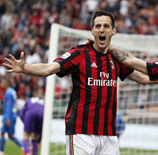 AC Milan's Nikola Kalinic, left, celebrates with his teammate Patrick Cutrone after scoring his side's third goal during the Serie A soccer match between AC Milan and Fiorentina at the San Siro stadium in Milan, Italy, Sunday, May 20, 2018