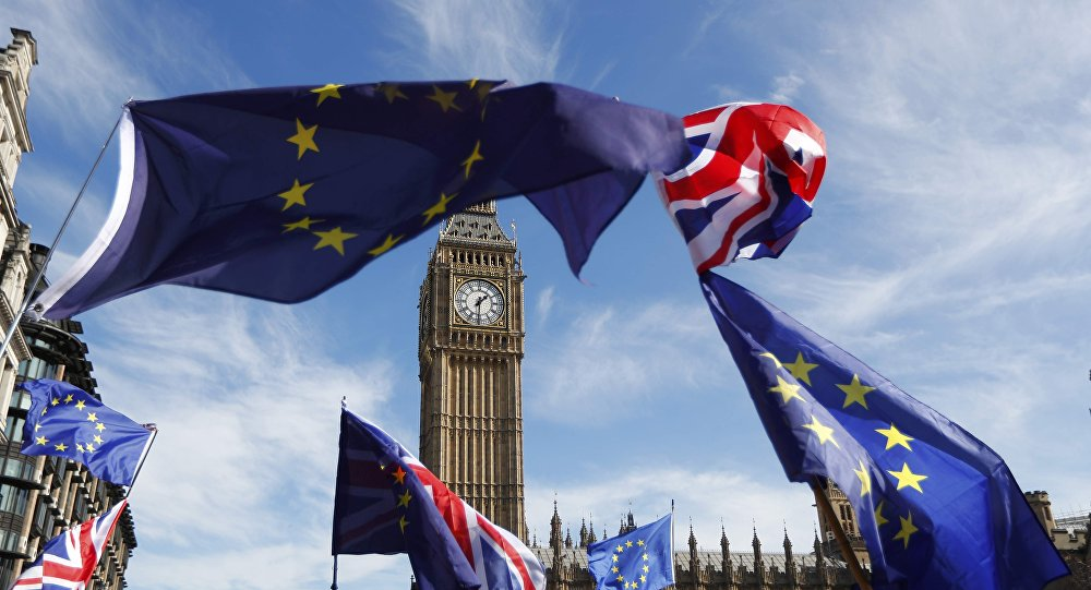 EU and Union flags fly above Parliament Square during a Unite for Europe march, in central London, Britain