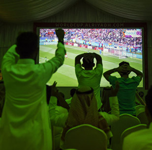Saudi football fans cheer for their national team during their Russia 2018 World Cup Group A football match against Russia at a fan tent in the capital Riyadh on June 14, 2018