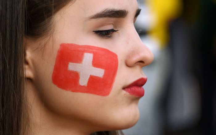 Gettin' Cheeky With It: Fans Paint Faces With World Cup Countries' Flags