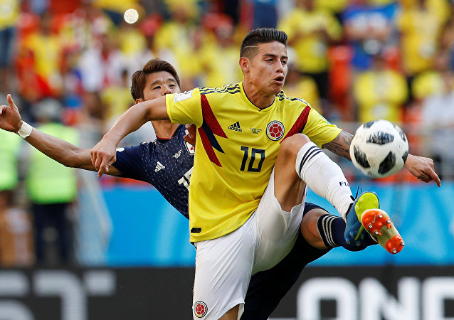 Japan's Hiroki Sakai in action with Colombia's James Rodriguez