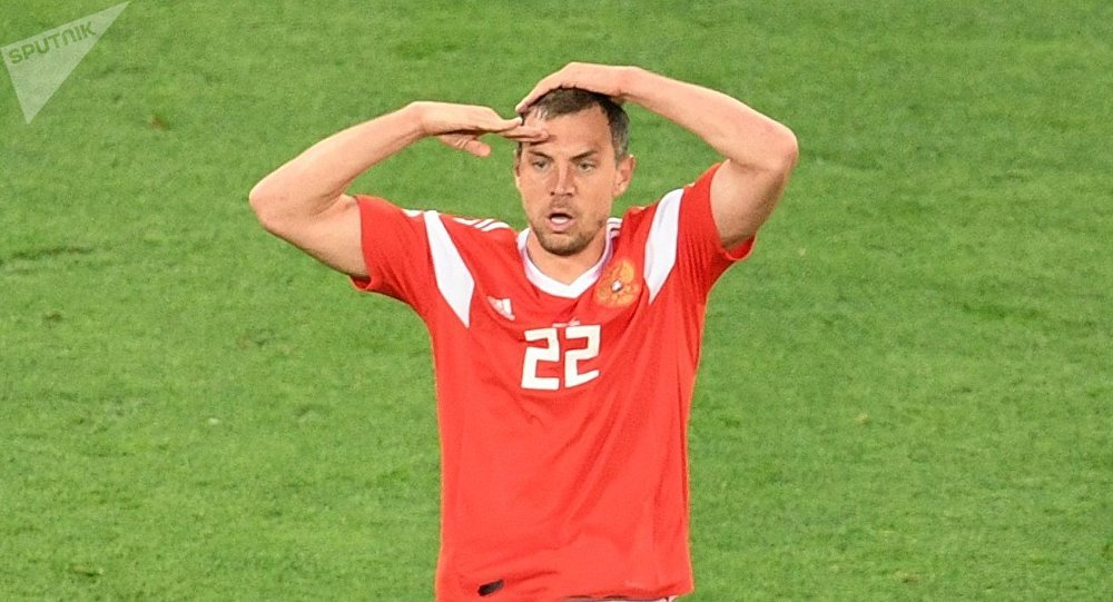 Russia's Artyom Dzyuba celebrates team's third goal during the World Cup Group A soccer match between Russia and Egypt at the St. Petersburg Arena in St. Petersburg, Russia, June 19, 2018