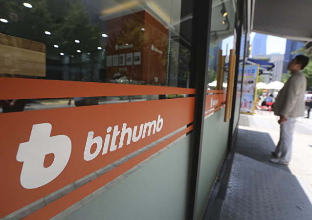 A man watches the prices of bitcoin at Bithumb cryptocurrency exchange in Seoul, South Korea, Wednesday, June 20, 2018