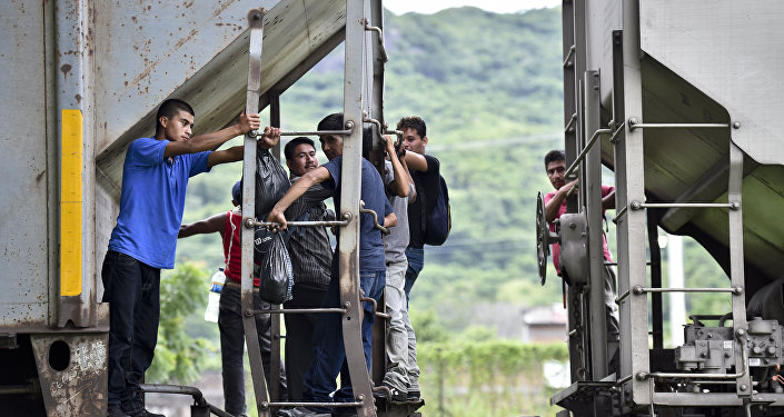 Central American migrants ride the train called The Beast in their attemp to reach the border between Mexico and the United States on September 1, 2014 in Arriaga, Chiapas state, Mexico.