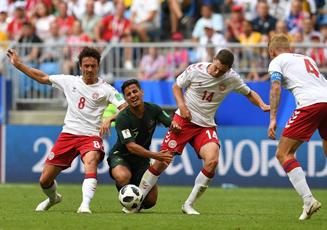 From left: Denmark's Thomas Delaney, Australia's Mathew Leckie, Denmark's Henrik Dalsgaard and Simon Kjaer struggle for a ball during the World Cup Group C soccer match between Denmark and Australia at the Samara Arena, in Samara, Russia, June 21, 2018