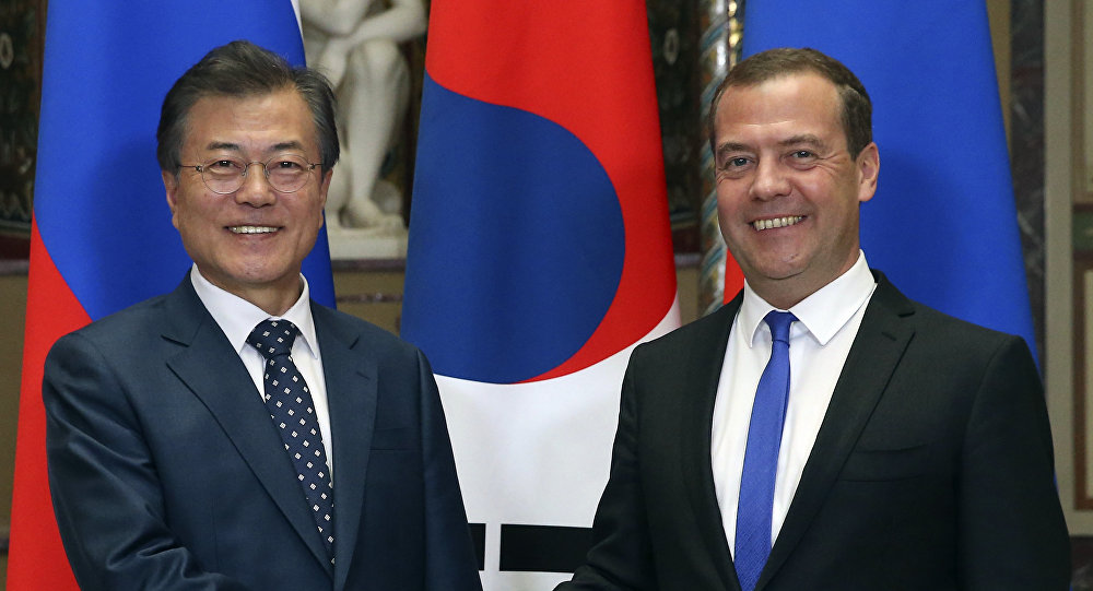 South Korean President Moon Jae-in, left, and Russian Prime Minister Dmitry Medvedev shake hands prior to their talks in Moscow, Russia, Thursday, June 21, 2018.