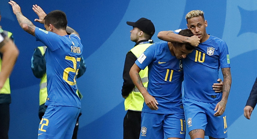 Philippe Coutinho, second right, is embraced by teammate Neymar, right, after he scored his team's first goal during the group E match between Brazil and Costa Rica at the 2018 soccer World Cup in the St. Petersburg Stadium in St. Petersburg, Russia, Friday, June 22, 2018