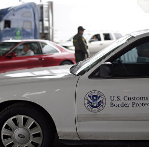 A US Customs and Border Patrol agent keeps watch at a checkpoint station.