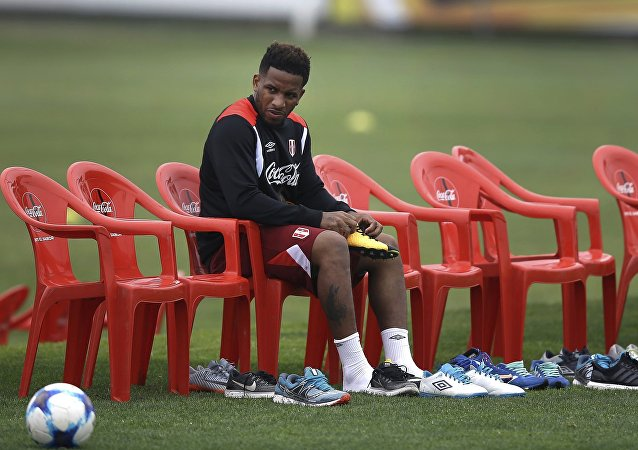 (File) Peru's Jefferson Farfan puts on his kleats before a practice session of the national soccer team in Lima, Peru, Wednesday, Oct. 4, 2017