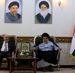 Iraqi Prime Minister Haider al-Abadi, who's political bloc came third in a May parliamentary election, meets with cleric Moqtada al-Sadr, who's bloc came first, in Najaf
