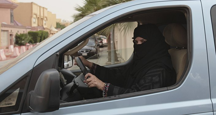 FILE- In this Saturday, March 29, 2014 file photo, a woman drives a car in Riyadh, Saudi Arabia, as part of a campaign to defy Saudi Arabia's ban on women driving.