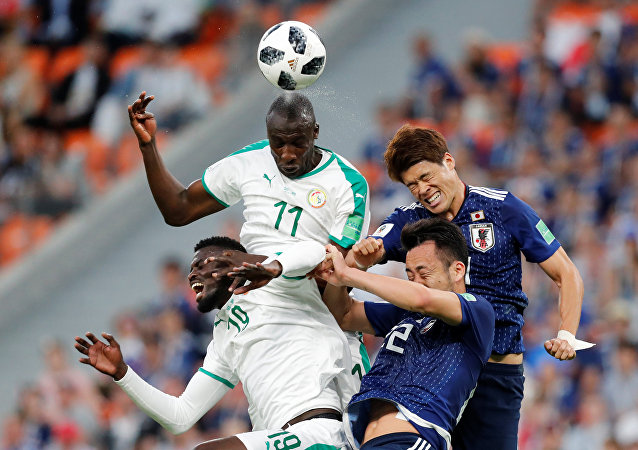 Soccer Football - World Cup - Group H - Japan vs Senegal - Ekaterinburg Arena, Yekaterinburg, Russia - June 24, 2018 Japan's Hiroki Sakai and Maya Yoshida in action with Senegal's Cheikh N'Doye and M'Baye Niang
