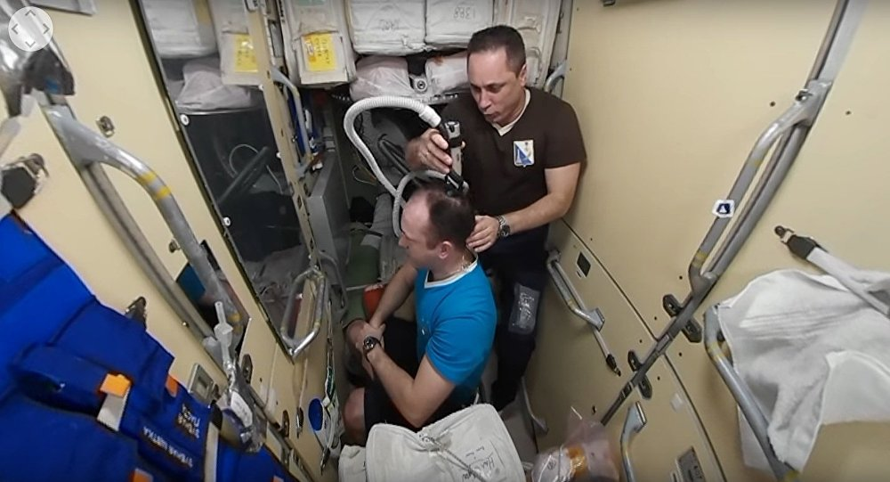 The Russian State Corporation Roscosmos has published a 360-degree video on its website showing Russian cosmonaut Anton Shkaplerov cutting his colleague Alexander Misurkin's hair on board the International Space Station