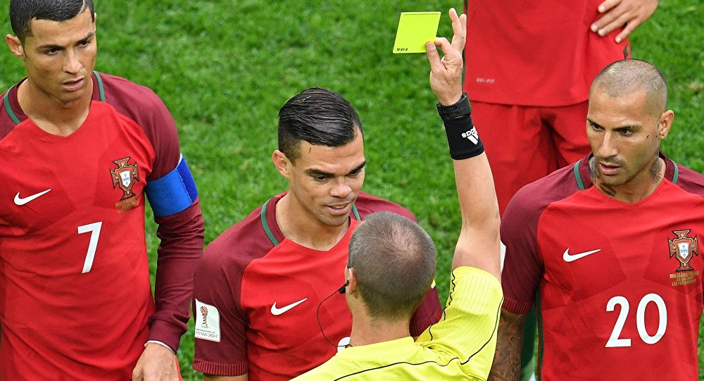 The referee Mark Geiger talks to an unseen player during the World Cup Group B soccer match between Portugal and Morocco at the Luzhniki stadium, in Moscow, Russia, June 20, 2018.