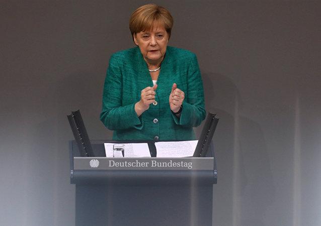 German Chancellor Angela Merkel addresses the German lower house of parliament Bundestag in Berlin, Germany, June 28, 2018