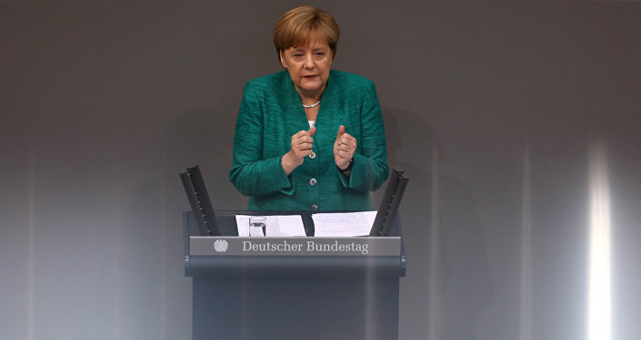 German Chancellor Angela Merkel addresses the German lower house of parliament Bundestag in Berlin, Germany, June 28, 2018