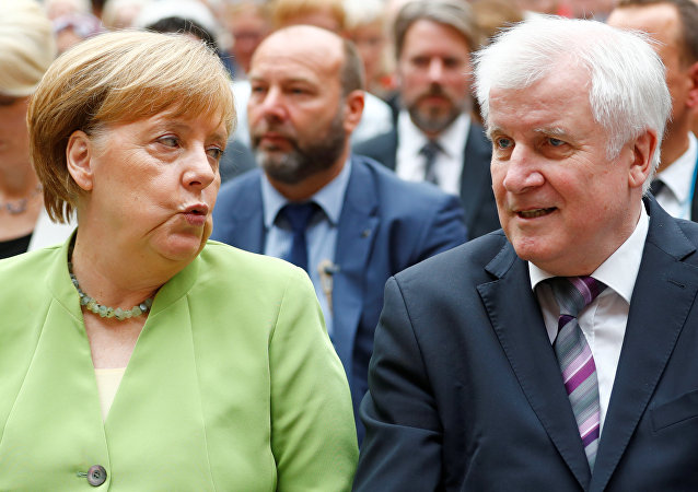 German Chancellor Angela Merkel and German Interior minister Horst Seehofer attend an event to commemorate victims of displacement in Berlin, Germany, June 20 2018