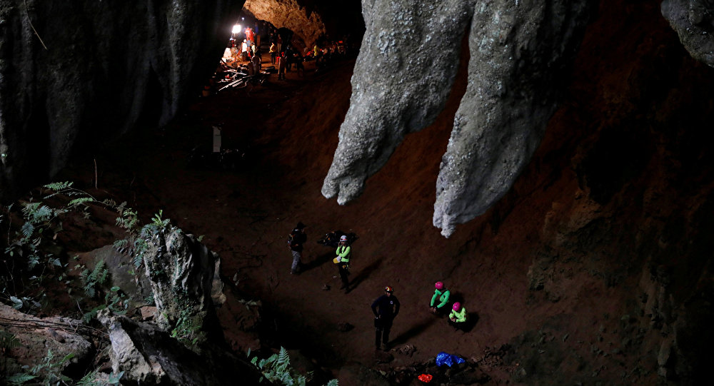 Rescue workers are seen in Tham Luang caves during a search for 12 members of an under-16 soccer team and their coach, in the northern province of Chiang Rai, Thailand, June 27, 2018.