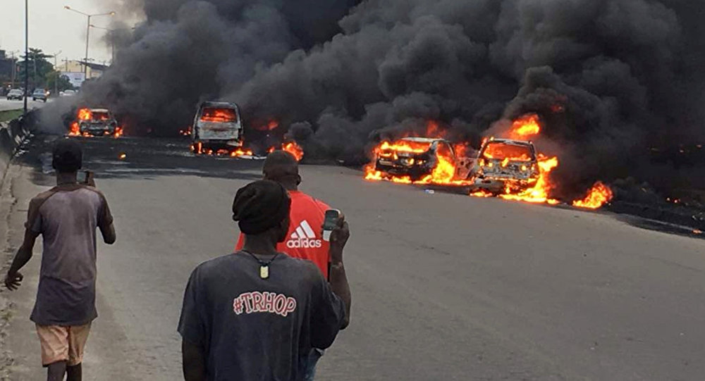Smoke rises above the cars in fire on a street in Lagos, Nigeria, June 28, 2018 in this picture obtained from social media