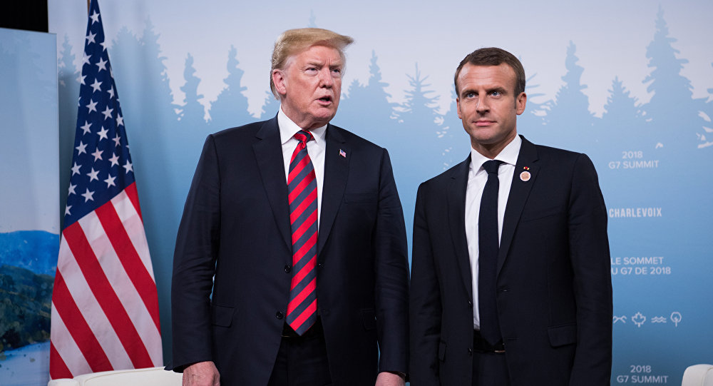 US President Donald Trump and French President Emmanuel Macron hold a meeting on the sidelines of the G7 Summit in La Malbaie, Quebec, Canada, June 8, 2018