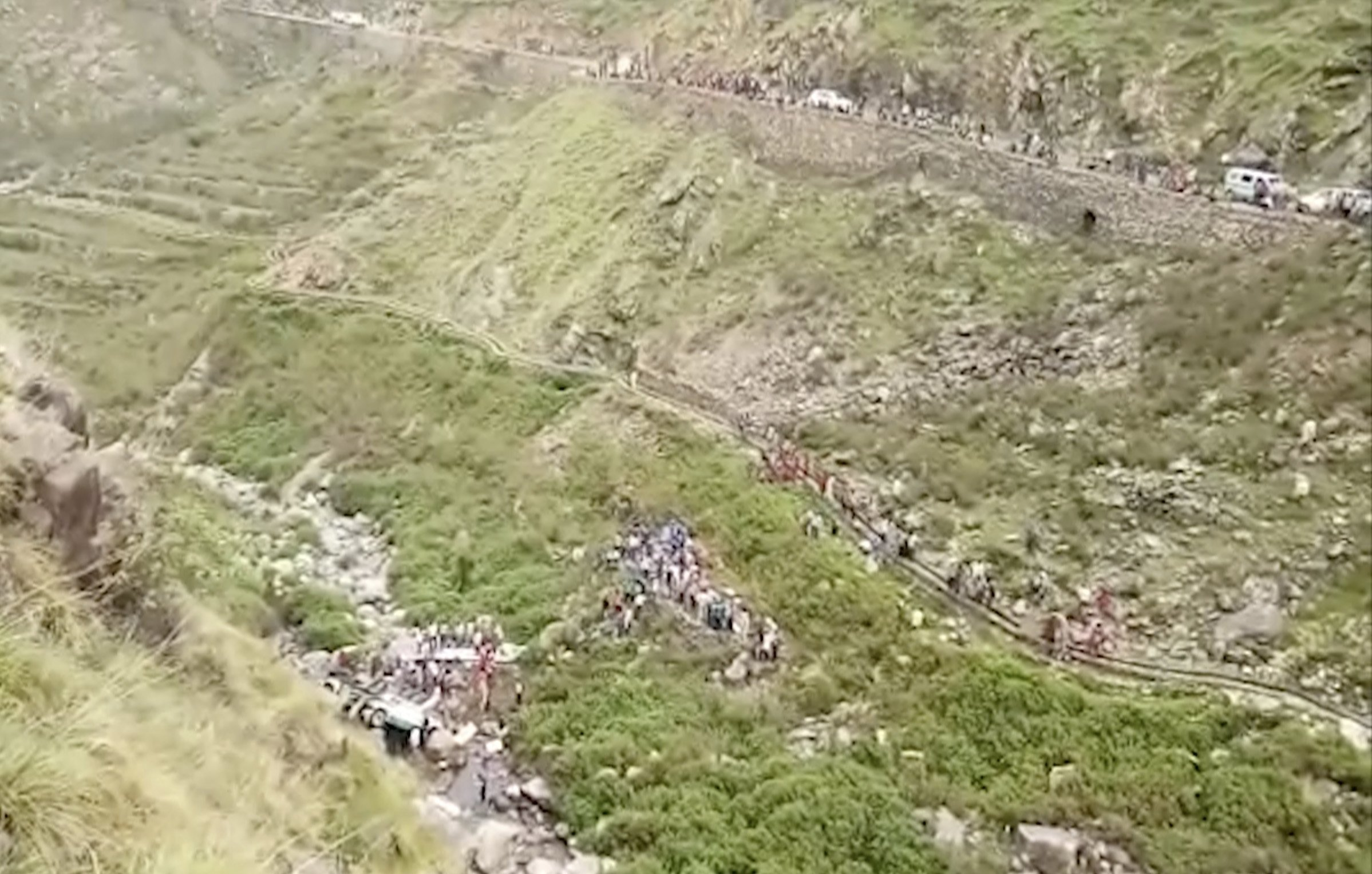 In this grab made from video provided by KK Productions, shows the area of a deadly bus accident in Uttarakhand's Paudi Garhwal district, northern India, Sunday, July 1, 2018