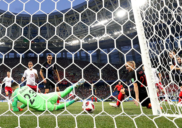 World Cup - Round of 16 - Croatia vs Denmark - Nizhny Novgorod Stadium, Nizhny Novgorod, Russia - July 1, 2018 Denmark's Mathias Jorgensen (hidden) scores their first goal past Croatia's Danijel Subasic