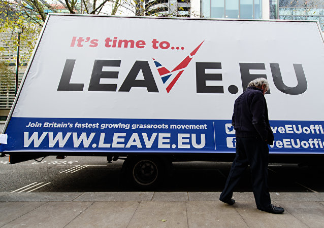 A man walks past a campaign poster ahead of a press briefing by the Leave.EU campaign group in central London on November 18, 2015