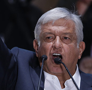 Presidential candidate Andres Manuel Lopez Obrador delivers his victory speech in Mexico City's main square, the Zocalo, late Sunday, July 1, 2018.