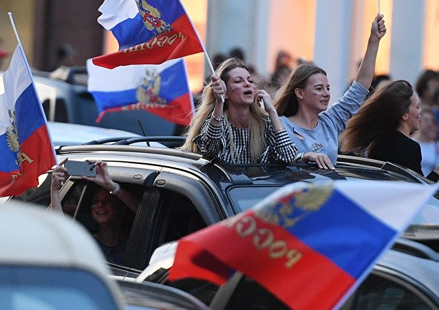 Fans celebrate the victory of the Russian national team