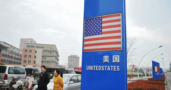 This file picture taken on April 5, 2018 shows a sign with a US flag outside a supermarket selling foreign goods in Qingdao, in China's eastern Shandong province