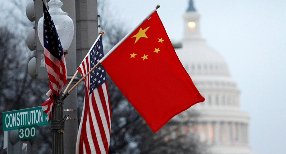 FILE PHOTO: The People's Republic of China flag and the U.S. Stars and Stripes fly on a lamp post along Pennsylvania Avenue near the U.S. Capitol