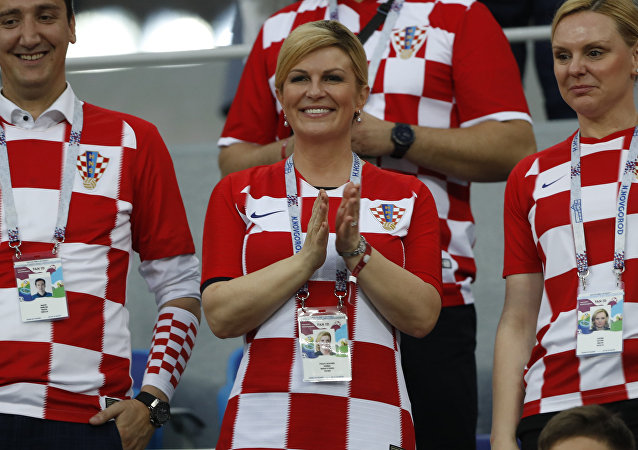 President Kolinda Grabar-Kitarovic, center, applauds prior the round of 16 match between Croatia and Denmark at the 2018 soccer World Cup in the Nizhny Novgorod Stadium, in Nizhny Novgorod , Russia, Sunday, July 1, 2018