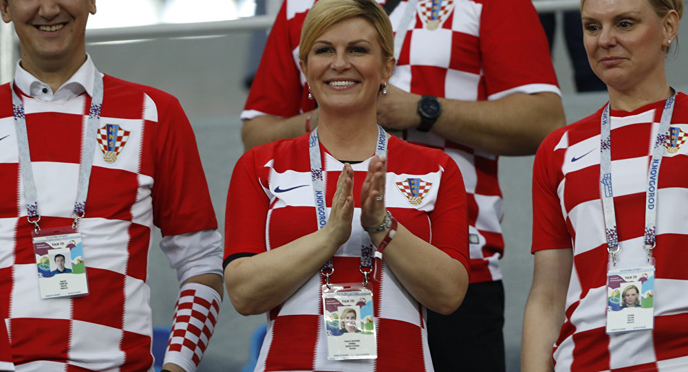 Soaked but smiling, Croatian president wins admirers