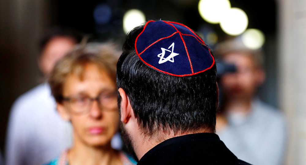 A member of Jewish community wearing a kippah talks to the media, before the start of the trail of a Syrian charged with assault after attacking an Arab-Israeli man wearing a kippah, at the Moabit court in Berlin, Germany, June 19, 2018