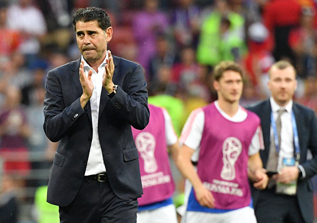 Dejected Spain's head coach Fernando Hierro leaves a pitch after team's loss at the World Cup Round of 16 soccer match between Spain and Russia at the Luzhniki stadium in Moscow, Russia, July 1, 2018