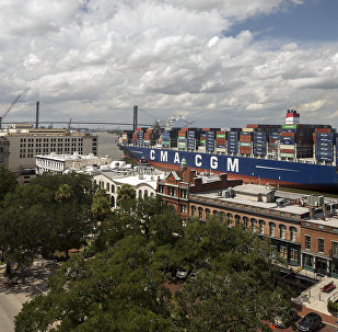 The 14,000 TEU container ship CMA CGM Theodore Roosevelt sails up river past River Street in Savannah, Georgia