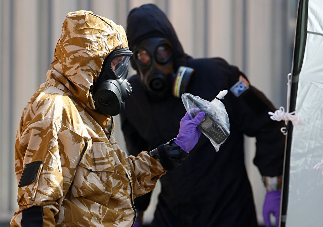 Forensic investigators, wearing protective suits, emerge from the rear of John Baker House, after it was confirmed that two people had been poisoned with the nerve-agent Novichok, in Amesbury, Britain, July 6, 2018