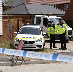 Policemen are outside the nerve agent victim Charlie Rowley in Amesbury. File photo