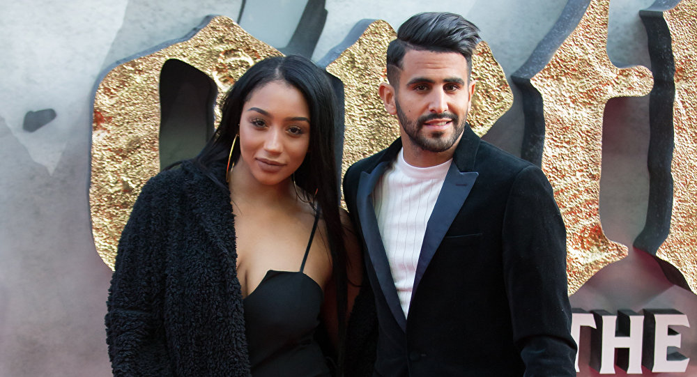 Leicester City footballer Riyad Mahrez (R) and his wife Rita pose for a photograph upon arrival at the European Premiere of King Arthur: legend of the Sword in London on May 10, 2017